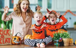 Happy Halloween! family mother and children getting ready for ho royalty free stock photography