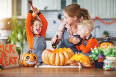 Happy Halloween! family mother and children getting ready for ho stock images