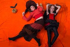 Mother and daughter in costumes for Halloween Stock Images