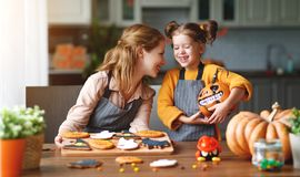 Happy Halloween! family mother and daughter getting ready for royalty free stock image