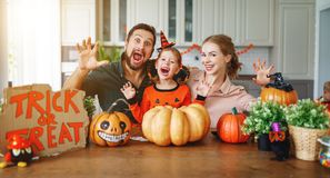 Happy Halloween! family mother father and child daughter cut pu stock photography