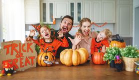 Happy Halloween! family mother father and children cut pumpkin f royalty free stock photos