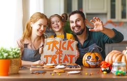 Happy Halloween! family mother, father and daughter getting read Royalty Free Stock Photo