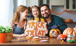 Happy Halloween! family mother, father and daughter getting read stock images