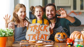 Happy Halloween! family mother, father and daughter getting read stock photos