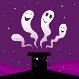 Happy Halloween ghosts flying around black chimney Royalty Free Stock Photos