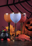 Happy Halloween ghoulish party cocktail drinks with color goblets Royalty Free Stock Photo