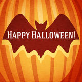 Happy halloween greeting card with bat carved in Royalty Free Stock Image