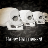 Happy halloween greeting card with human skulls Royalty Free Stock Photo