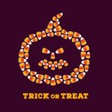 Happy Halloween greeting card with jack o lantern silhouette made of small candy corns. Royalty Free Stock Photography
