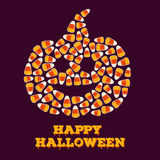 Happy Halloween greeting card with jack o lantern silhouette made of small candy corns. Royalty Free Stock Photo