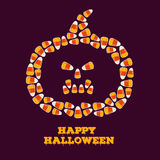 Happy Halloween greeting card with jack o lantern silhouette made of small candy corns. Stock Photography