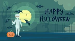 Happy Halloween Greeting Card Mummy At Night On Cemetery Graveyard With Pumpkin Banner Stock Photos