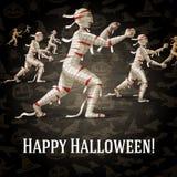 Happy halloween greeting card with walking mummies Stock Photo