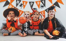 Happy Halloween! a group of children in suits and with pumpkins Stock Photos