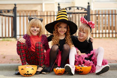 Happy Halloween. Group of happy Halloween girls with treats Stock Photo
