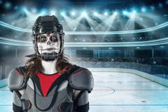 Happy halloween. hockey player in a hockey helmet and mask with a balloon against the backdrop or background of a hockey field. Al stock photography