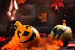 Happy Halloween holiday background with funny pumpkin and autumn leaves Stock Photography