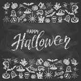 Happy Halloween with holiday decorations on black chalkboard  Stock Image