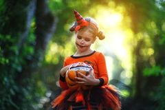 Happy Halloween! horrible creepy child girl in pumpkin costume Royalty Free Stock Image