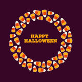Happy halloween inscription with circle frame made of small candy corns. Holiday trick or treat greeting card, poster. Stock Photography
