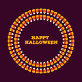 Happy halloween inscription with circle frame made of small candy corns. Holiday trick or treat greeting card, poster. Royalty Free Stock Photography