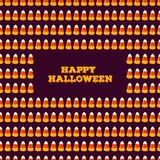 Happy Halloween inscription with frame made of small candy corns. Holiday trick or treat concept Royalty Free Stock Photo