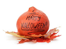 Happy Halloween inscription on the pumpkin with leaves Stock Photography