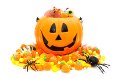 Happy Halloween. Halloween Jack o Lantern pail with pile of candy over white stock photos