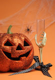 Happy Halloween Jack-o-lantern pumpkin with skeleton hand glass - vertical with copy space for your text here. Stock Photos