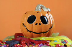 Happy Halloween Jack-o-Lantern pumpkin on top of candy Stock Photo