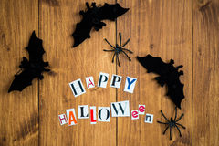 Happy Halloween Letters cut out from the Magazines, Bats and Bla Stock Images