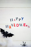 Happy Halloween Letters cut out from the Magazines, Bats and Bla Stock Photo