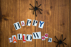 Happy Halloween Letters cut out from the Magazines and Black Spi Royalty Free Stock Photos