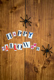 Happy Halloween Letters cut out from the Magazines and Black Spi Royalty Free Stock Images