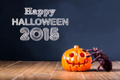 Happy Halloween 2015 message with pumpkin and spider. On black background Royalty Free Stock Photos