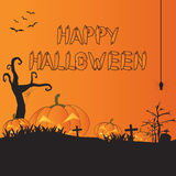 Happy Halloween night with pumpkins and hanging spider on orange Stock Images