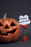 Happy Halloween sign with orange Jack-o-lantern - vertical with copy space. Stock Images