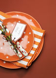 Happy Halloween orange polka dot and stripes dinner table setting, with copy space.  Vertical. Royalty Free Stock Photos