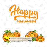 Happy Halloween - party hand drawn lettering and sketch with cute pumpkins on the porch. Fun colorful brush ink Royalty Free Stock Photography