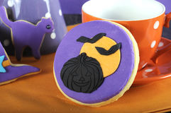 Happy Halloween party trick or treat purple and orange cookie close up Royalty Free Stock Photos