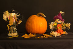 Happy Halloween!. The picture shows two scarecrows and halloween pumpkins stock photography