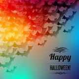 Happy Halloween postcard with black bats in the corner on a rainbow background. Happy Halloween postcard with black bats in the corner on a rainbow background stock illustration