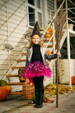 Happy halloween. Pretty little girl in a costume of witch with her magic broom celebrating halloween. Trick or treat. Halloween party Stock Photography
