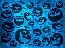 Happy halloween pumpkins with bats on blue background wallpaper Stock Photos