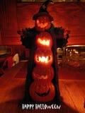 Happy Lit up Halloween Pumpkins. Happy Halloween Pumpkins lit up to look like a wizard. Very festive with an orange glow stock photo