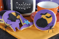 Happy Halloween purple and orange cookies with spiders and cookie jar - close up. Royalty Free Stock Photography