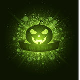 Happy Halloween . Ribbon banner with text. Abstract bright flash of light with green lights. Green cartoon evil pumpkin. Luxurious Royalty Free Stock Image