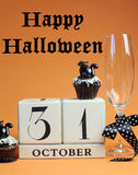 Happy Halloween save the date white block calendar with champagne glass and chocolate muffins - vertical with text Royalty Free Stock Images