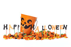 Happy Halloween sign with candy & candy bucket Royalty Free Stock Photo